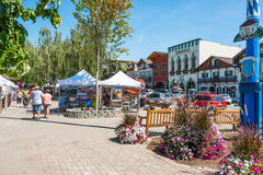 Leavenworth Washington Tourism Art Show. LEAVENWORTH, WA - AUG 1, 2015: Art show and Bavarian themed buildings on street in Cascade Mountain tourist town of stock photo