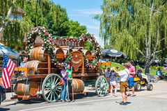 Leavenworth Washington Tourists Photograpphy. LEAVENWORTH, WA - AUG 1, 2015: Tourists having photo taken in front of beer barrel float in Bavarian themed Cascade stock photos
