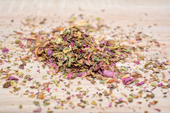 Leaves amaranth tea, scattered on the wooden table. Mound of tea Royalty Free Stock Image