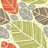 Leaves on the beige background. Seamless pattern.Leaves on the beige background.Seamless pattern can be used for wallpaper, pattern fills, web page Royalty Free Stock Photography