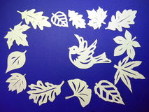 Leaves and bird, paper cutting Stock Photography