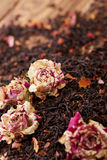 Leaves of black tea with rose petals Royalty Free Stock Photography