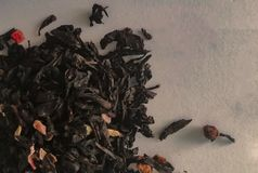 Leaves of black tea on a white background stock image