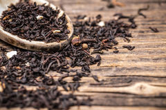 Leaves of black tea. In wooden spoon stock photography