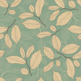 Leaves. On a blue background in seamless pattern Stock Photos