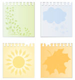 Leaves of a calendar with the image of seasons Stock Photo