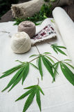 Leaves of cannabis and balls of yarn on canvas Stock Images
