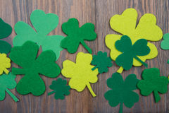 Leaves of clover on brown wooden background. St.Patricks Day Stock Photo