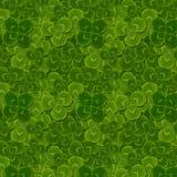 Leaves clover quatrefoil trefoil shamrock pattern. St. Patrick green background stock photo