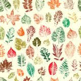 Leaves are colored silhouettes of trees and bushes. Seamless pat stock illustration