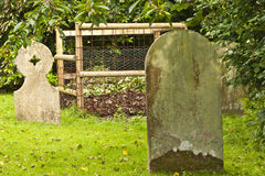 Leaf bin in a country churchyard Royalty Free Stock Photography