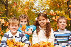 Leaves falling on children Stock Photography