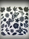 Leaves , flowers and butterflies. Paper cutting Royalty Free Stock Image