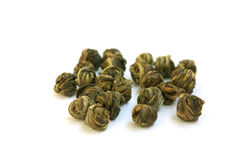 The leaves of green tea braided in balls. Isolated on a white background Royalty Free Stock Photo
