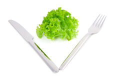 Leaves lettuce with fork and knife Royalty Free Stock Photos