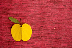Leaves like Apple on a red background Stock Image
