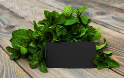 Leaves of mint with label Stock Images