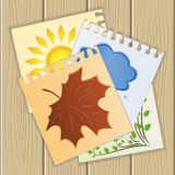 Leaves of a paper with seasons . eps10 Stock Photo