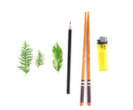 Leaves, pencil, chopsticks and lighter. On white background Stock Photos
