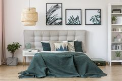 Leaves posters in bedroom interior Royalty Free Stock Photography