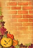 leaves pumpkin on wall Brick brown background Royalty Free Stock Image