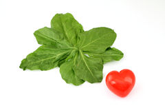 Leaves of spinach Red heart shape on Royalty Free Stock Image