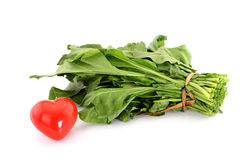 Leaves of spinach Red heart shape on Royalty Free Stock Images