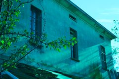 Leaves of a tree near an old house. Montecchio, Italy Royalty Free Stock Photo