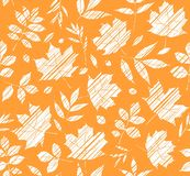 The leaves of the trees, seamless background, orange, shading, vector. White leaves on an orange field. Vector color pattern. The leaves are shaded diagonally a Stock Images