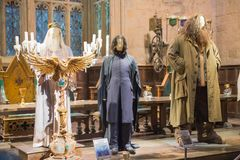 Costumes display in the dining hall of Hogwarts. Decorations for the Harry Potter film. Leavesden, London, UK - 1 March 2016: Costumes display in the dining hall royalty free stock photography