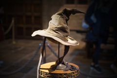 Hogwarts School of Witchcraft and Wizardry, model against of black background. Leavesden, London, UK - 1 March 2016: The sorting Hat. Costume display of Warner Stock Photo
