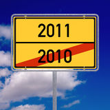 Leaving 2010 entering 2011. German road sign indicating that the new year 2011 is ahead vector illustration