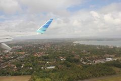 Leaving Bali, view of the island from the airplane Stock Photos