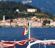Leaving Bellagio by boat, italian naval flag. Lake Como, Lombardy, Italy stock photo