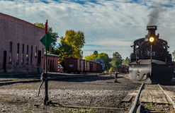 Leaving Chama. A steam locomotive pulls a train out of the Chama, New Mexico depot Stock Photo