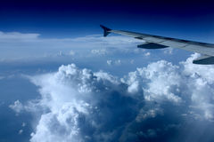 Leaving The Clouds Behind. On top of the clouds over Toronto Royalty Free Stock Photo