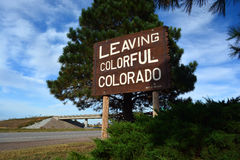 Leaving Colorful Colorado Highway Sign. A carved wooden sign saying Leaving Colorful Colorado at the Kansas-Colorado state line on I-70 Royalty Free Stock Image