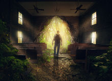 Leaving the empty church. A man leaves from an empty church in the forest Stock Photography