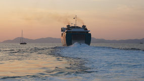 Leaving ferry. A ferry leaving the port at sunset Royalty Free Stock Images