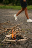 Leaving fire place. Still-life of small fire and walker Stock Images