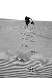 Leaving footpints in the desert Royalty Free Stock Images