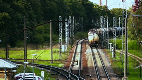 Leaving freight train composition. Shot from above. Exiting railway tanks row. The train enters a curve stock video footage
