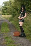 Leaving home. Goth girl waiting for her lift after leaving home Royalty Free Stock Photos