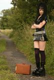 Leaving home. Goth girl still waiting for her bus royalty free stock images