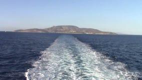 Leaving Irakleia island. Trails of ferryboat leaving Irakleia island in greece stock footage