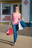 Leaving the mall. A young lady after a long day at the mall royalty free stock image