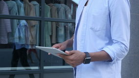 Leaving Office, Walking Man Using Tablet for Browsing. Creative designer , businessman stock video footage