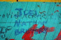 Leaving One's Mark. Old wooden bar with people leaving their mark stock photography