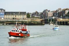 Leaving the port. Small fishing boats leaving the port of Le Treport in Upper Normandy in the morning stock photography