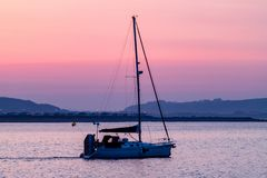 Leaving Porthcawl Harbour at Dawn royalty free stock photos